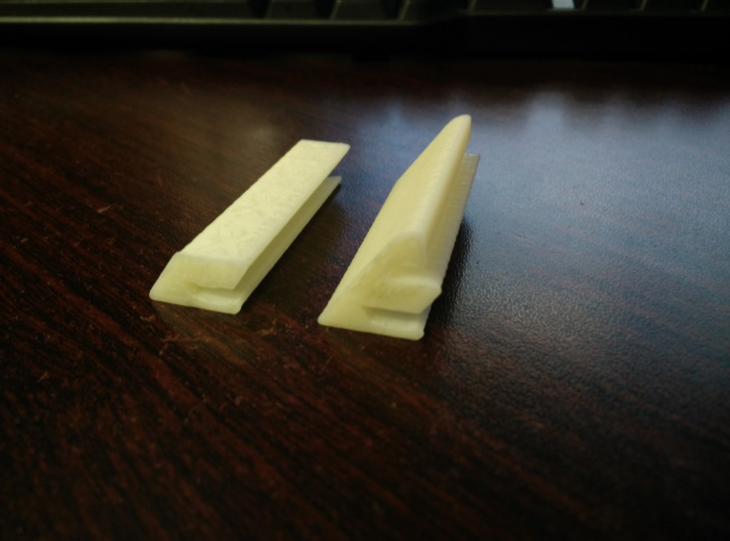Right: A replica of the factory clip made from scratch. Left: A modify of that same clip, without the segment that attaches to the window.