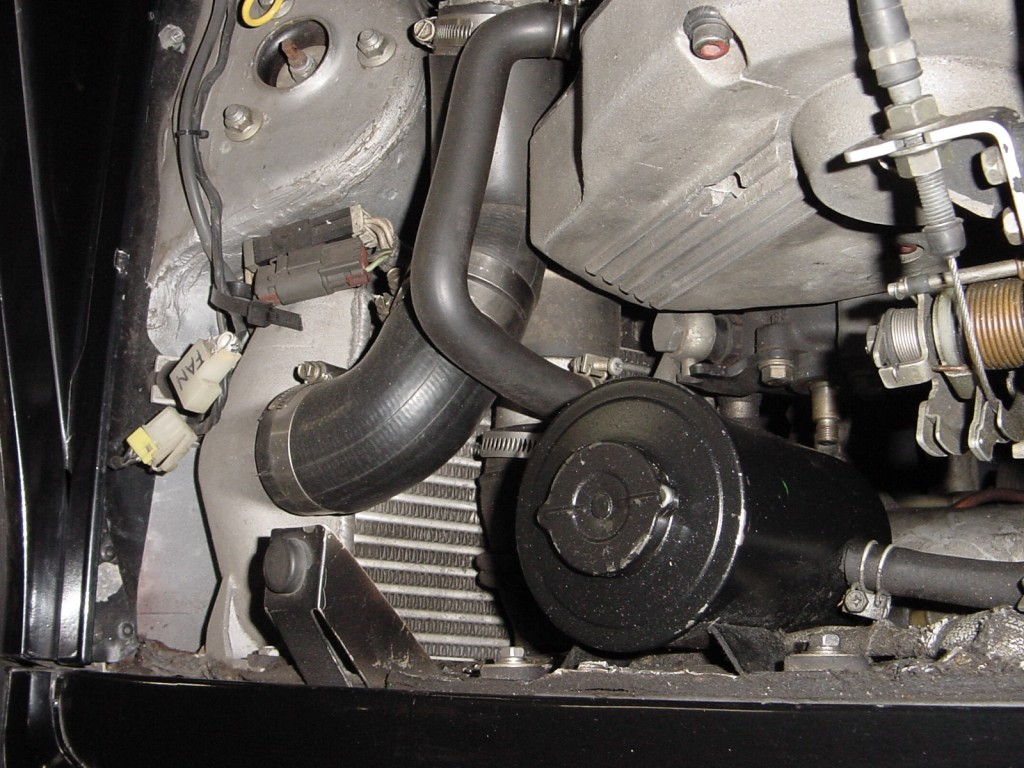 Fan is disconnected and power steering pump has no pulley.... Nissan is weird.