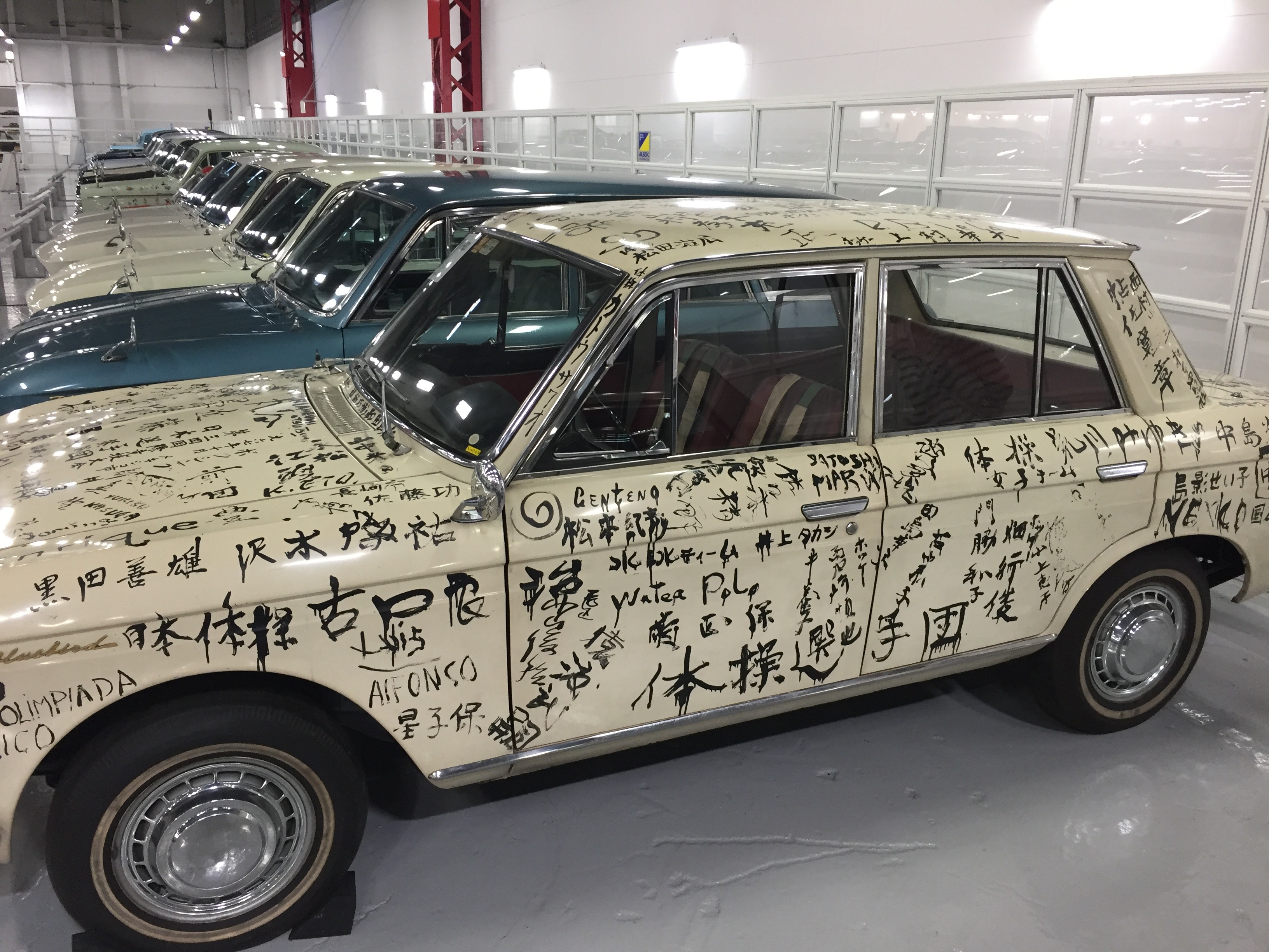 1968 Datsun Bluebird 1300. Covered in the signatures of the whole Japanese team on the last day of the 1968 Olympics in Mexico.